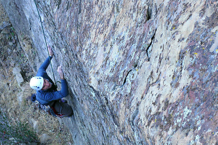 """Romain Wacziarg climbs through the first crux of """"Permanent Income Hypothesis"""" during the route's first ascent."""