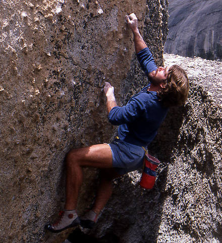 Rick Cashner bouldering at the Knobs.<br> Photo by Blitzo.
