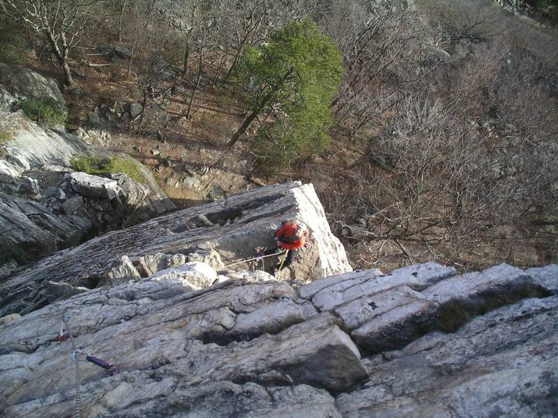 Looking back at the belay from the upper part of pitch two.