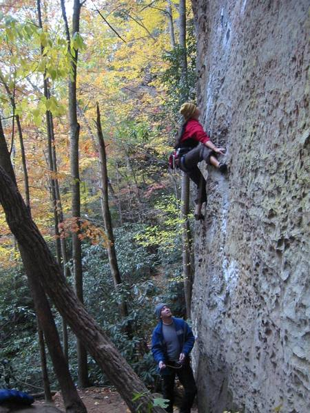Tina S on 10a To Defy the Laws of Tradition at Red River Gorge with Gary belaying.