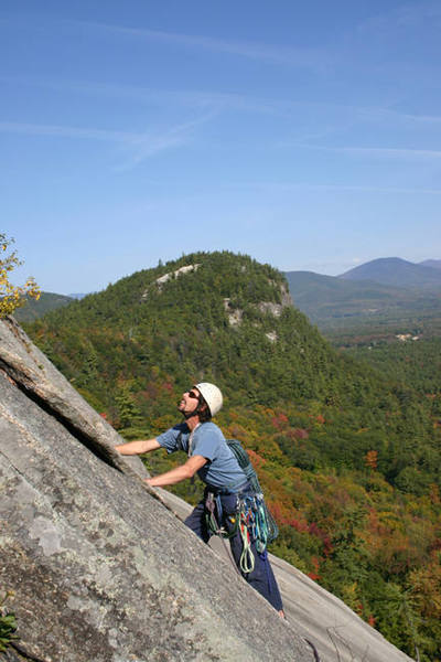 My dad (Ernie Hansche) on sliding board (5.7) with Cathedral Ledge in the background...