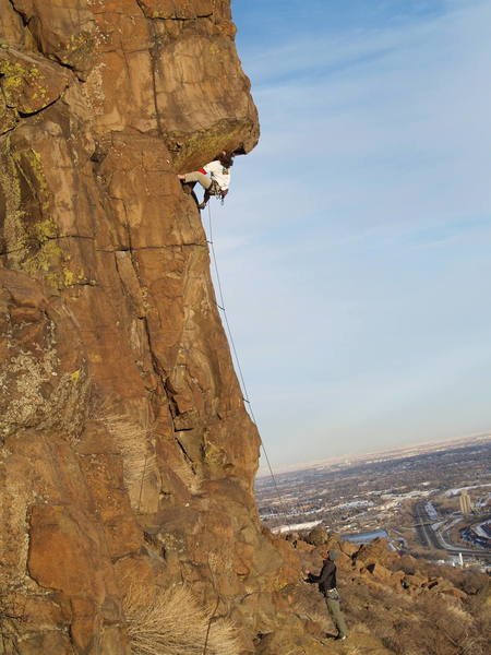Tim Caldwell with the high heel, right before the roof crux.