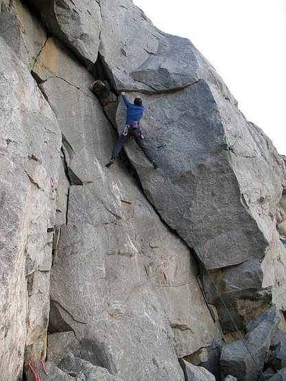 Just below the 4th bolt, and the crux, of Utopia (5.10b), Riverside Quarry