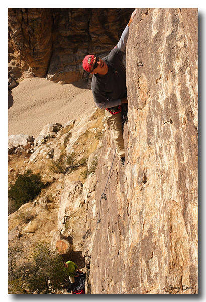 """Mark leading """"Solitary"""".  Stacy is taking photo girth-hitched to the chains of the neighboring route """"Birdman""""."""