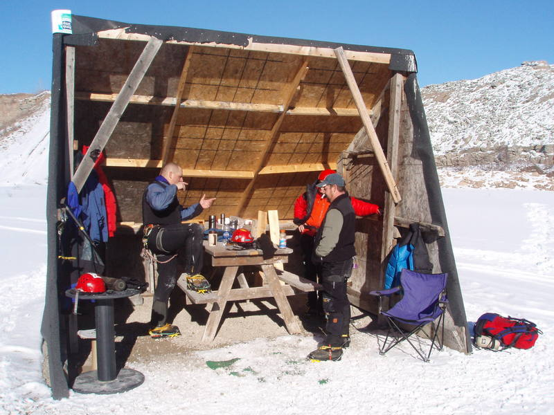 Ron Long, Dave Sprissler and Eric Relien, sharing stories at the Ice Pit.<br> <br> Photo:  James Schroeder