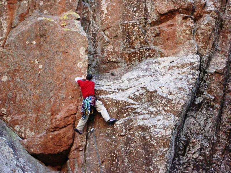 Daniel diverging off of the Ker Plunk ramp onto Monkeys Way (Crux).  A small cam protects the 5.7 move well.