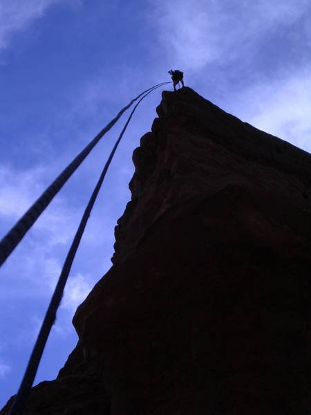 Travis Coster rappeling the Colorado Northeast Ridge.