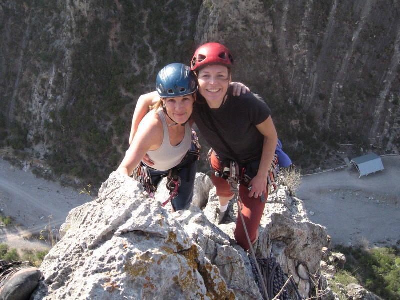 Marga and Christa enjoying a warm February day on the summit of Dope Ninja.
