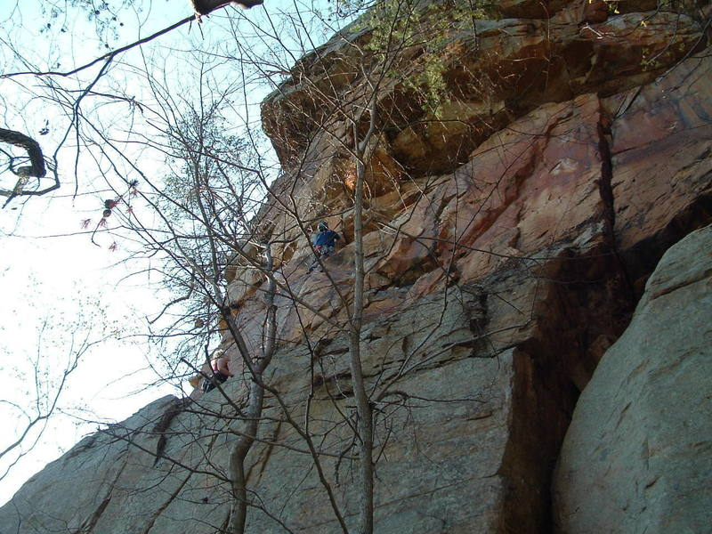 Climbing pitch 2. Pitch 1 follows the right leaning crack below the belayer