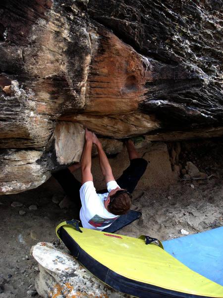 Christian working a boulder problem.