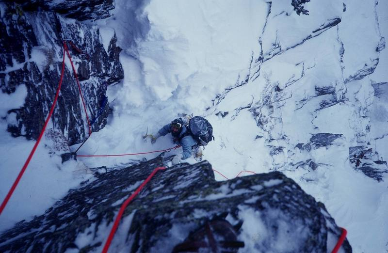 """First ascent of """"Lost in the Woods"""" Hallett Peak.<br> <br> Climber: Olaf Mitchell.<br> <br> Photo: Bruce Sposi."""