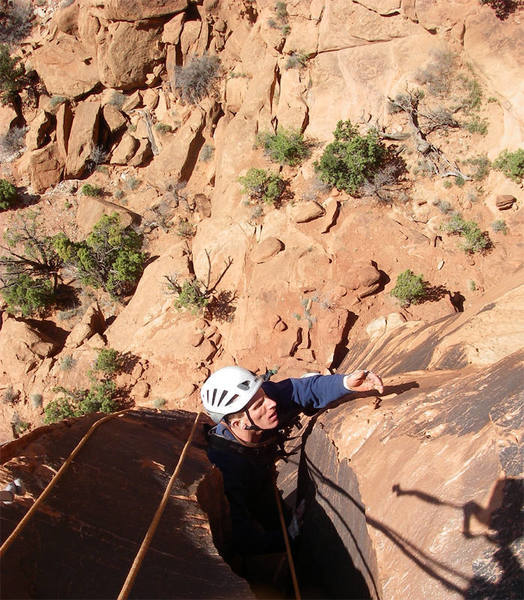 Andy Laakmann questioning the quality of the holds as he exits the second chimney. The first pitch was generally solid, the rest, not so much.