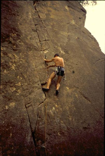 """Tony Bubb a little higher on """"Supercrack"""" (5.12-) at Singapore's Dairy Farm climbing area. Photo by Lois Tan, 3/2005."""
