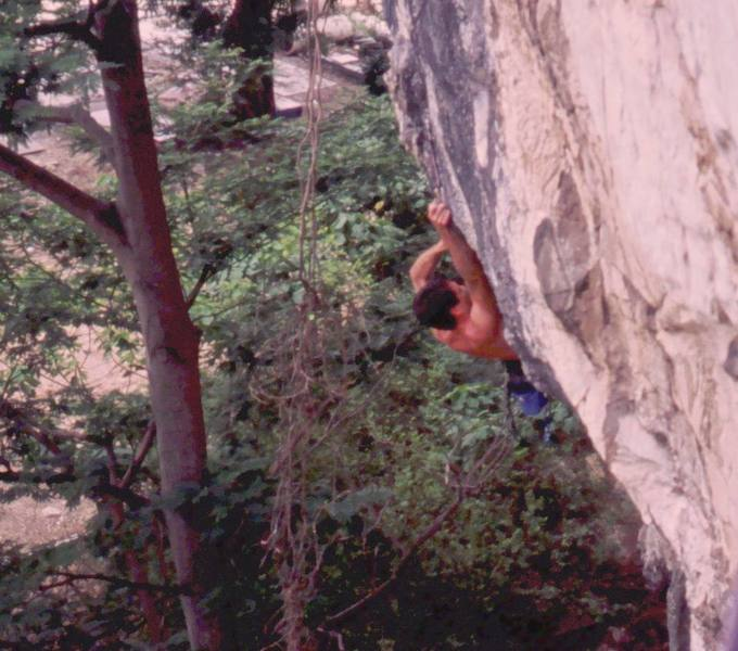 Tony coming out of the big roof on Lost Monkey (5.11) at Nanyang Wall of the Batu Caves area in K.L. Malaysia. Photo by Kenny Low, 2005.