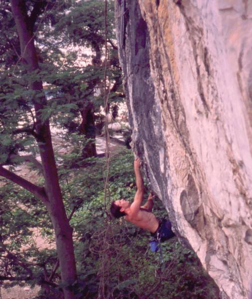 Tony coming going for the crux of 'Lost Monkey (5.11)' at Nanyang Wall of the Batu Caves area in K.L. Malaysia. Photo by Kenny Low, 2005.