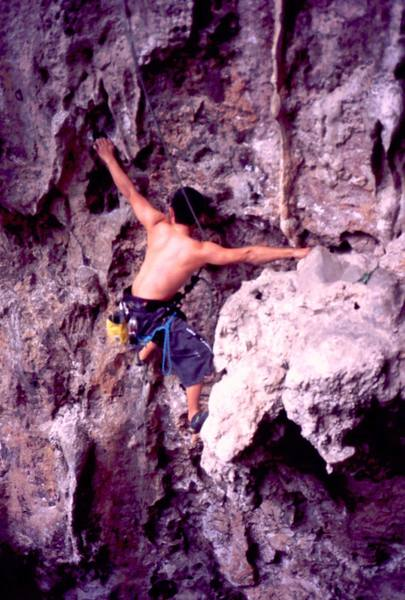 An unknown climber on the steep juggy start of 'Parang Buta (5.10)' at Nanyang Wall of the Batu Caves area in K.L. Malaysia. Photo by Tony Bubb 2005.