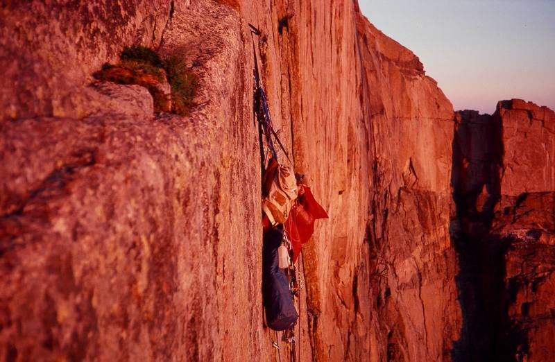 """Photo: Olaf Mitchell.<br> Yellow Wall early '80s.<br> A long, leader fall right at dark resulted in this climber spending a pathetic night 100' above his partner with only half the food and bivy gear. It was amazing to witness them raising and lowering stuff from their haul bag with head lamps. Their comment was: """"We had considered this as a possibility, and dismissed it as impossible!""""<br>"""