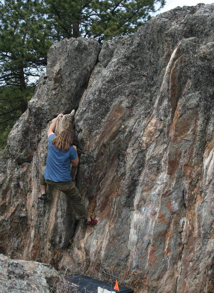 this is the left most boulder when viewed from the road, this is roughly v0/1 with a problem to the left and 4/5 other problems on the right from here. ranging from v1-v4+