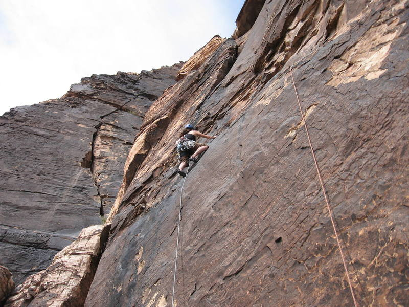 Tamara wrapping up the exciting traverse on p3; bighorn in background