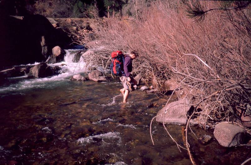 The early spring and late fall approach to the West Ridge can be a plesant and mellow stream crossing. Peter Spindloe enjoys the feel of it in April, 2000. Photo by Tony Bubb.