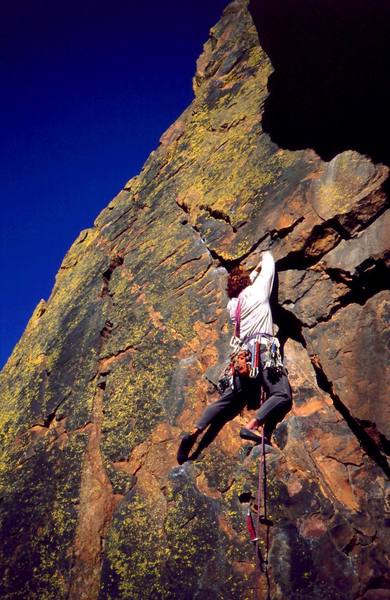 Matt Robertson heads up the colorful first pitch of Grand Giraffe (5.9) on Redgarden Wall in Eldo. Photo by Tony Bubb, 11/2001.