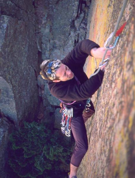 Tony Bubb struggles for the thin-hands jams at the crux of the Potato Chip Route (sandbagged 10c) in Eldo, right after the wide section. Photo by Joseffa Meir, 2002.