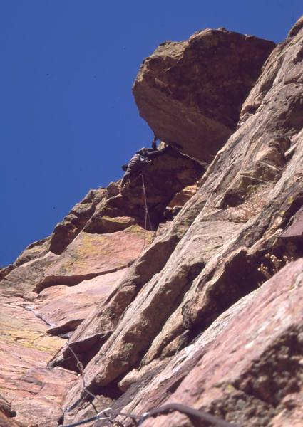 Tony Bubb sews it up on the RastaMan Roof variation (5.9+) of Reggae, on the Wind Tower of Eldo. Photo by Joseffa Meir, 2002.