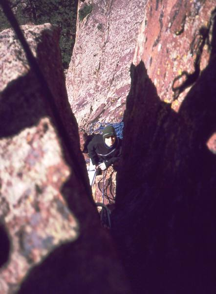 Joseffa Meir ponders her fate as she looks up through the starting slot of 'Initial Hangover' on Eldo's West Ridge. Photo by Tony Bubb, 2002.