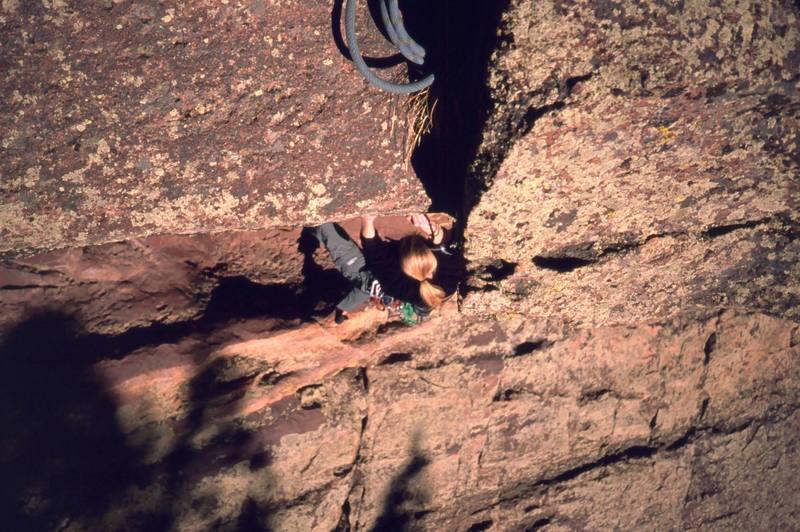 Jenny Schillinger follows on 'Super Scooper (5.9)' on the West Ridge of Eldo. Photo by Tony Bubb, 2003.
