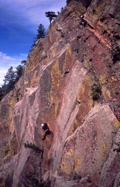 An unknown climber follows 'Pony Express (5.11)' on Eldo's West Ridge. Photo by Tony Bubb, 2003.