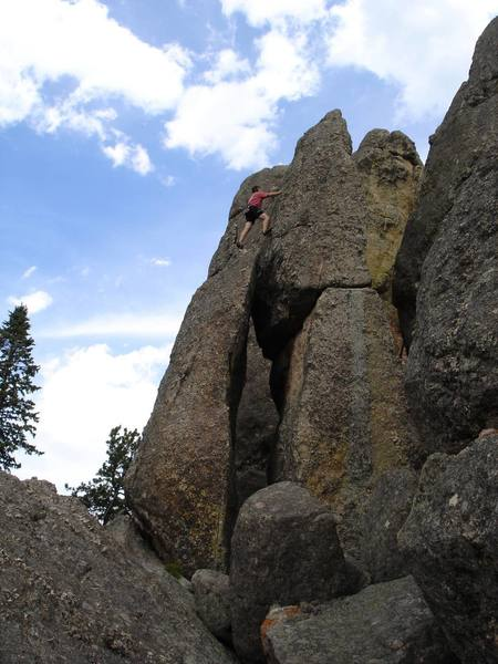 """Burt Lindquist moving onto the summit block of Stonehenge while climbing """"One Epic Leads to another""""."""