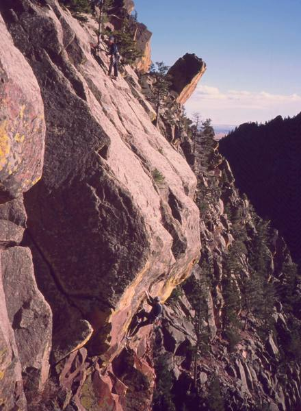 Unknown climbers atop of and following on 'Whiplash (5.10c)' on Eldo's West Ridge. Photo by Tony Bubb, 2003.