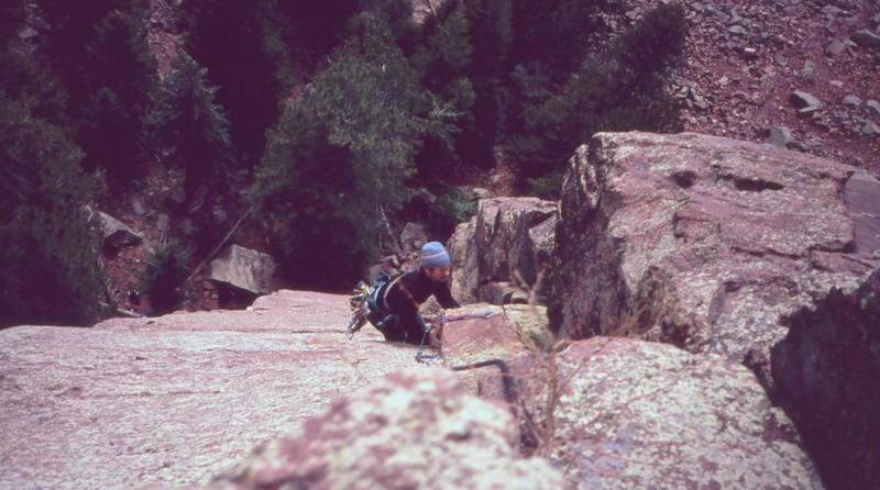 Jer Collins following P2 of the 'Center Route (5.11a)' on Rincon Wall in 2003. Photo by Tony Bubb.