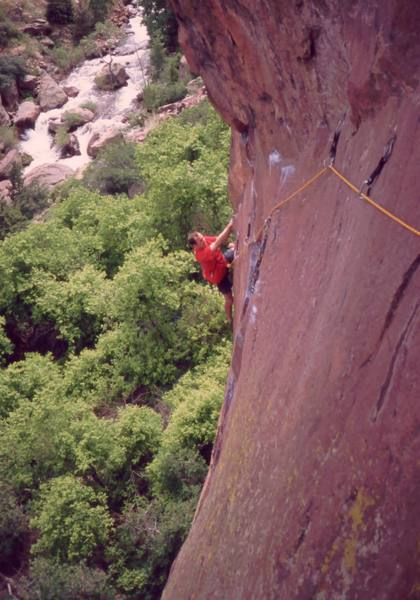 Josh Janes following at the first crux of 'Le Boomerang (5.11d)' on Eldo's Redgarden Wall, in 2004.