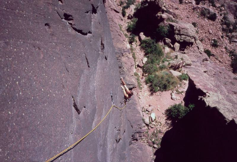 Josh Janes approaches the steep section on 'Night (5.11)' on Eldo's Redgarden Wall. Photo by Tony Bubb in 2004.