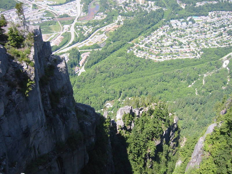 Looking down the North Gully of the Chief.  The Acrophobe towers are visible in the lower middle of the shot.  The finishing pitches are just around the corner of the buttress on the right.  The building in the upper middle with the brown roof is the hospital.  The Smoke Bluffs are just out of sight at the top of the image.