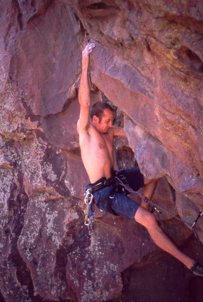 Shane Zentner arrives at the crux of 'M' on the Whale's Tail in Eldo.  Photo by Tony Bubb, 2004.