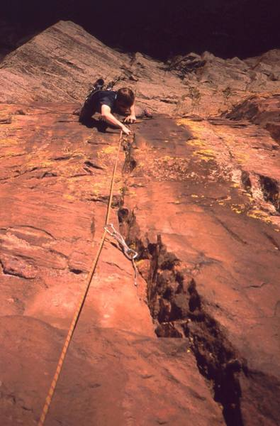 Dave Stewart in the crux on P2 of 'Three Old Farts Young At Heart (5.10)' on Eldo's Redgarden Wall. Photo by Tony Bubb, 2004.
