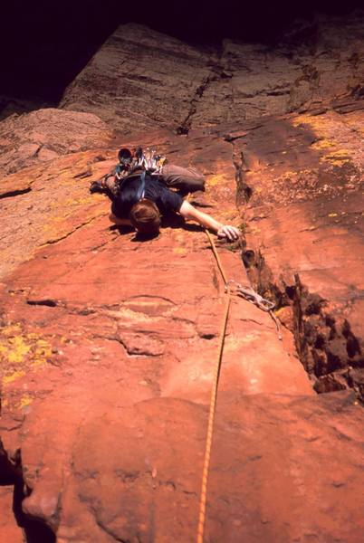 Dave Stewart being chased by shadows on the Crux of 'Three Old Farts Young At Heart (5.10d)' on Redgarden Wall, in Eldo. Photo by Tony Bubb, 2004.