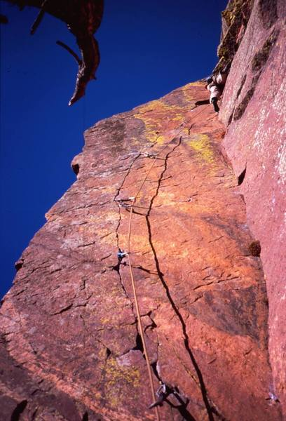 Josh Janes a little higher and into the tough stemming on 'Pony Express  (11c)', on Eldo's West Ridge. Photo by Tony Bubb, 2005.