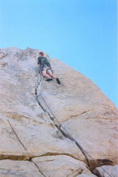 Chris nearing the top of Sail Away 5.8-