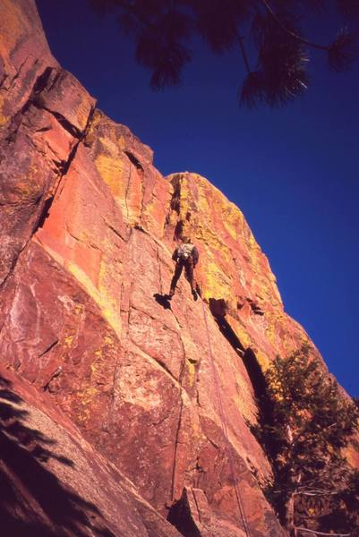 Jason Haas descends via the raps on 'Sooberb' on Eldo's West Ridge. The area glows with color at sunset. Photo by Tony Bubb, 2/2007.
