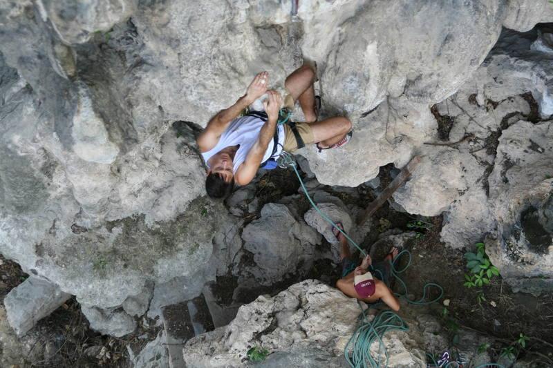 Tony Bubb getting started up 'Circumcision (6b)' at Nanyang Wall at Batu Caves, in K.L. Malaysia. Photo by Kenny Low, 2006.