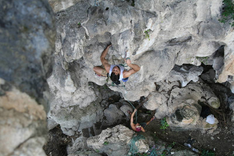 "Tony Bubb enjoying the good ""clipping holds"" (hardey-har-har)of 'Circumcision (6b)' on Nanyang Wall at Batu Caves, in K.L. Malaysia. Photo by Kenny Low, 2006."