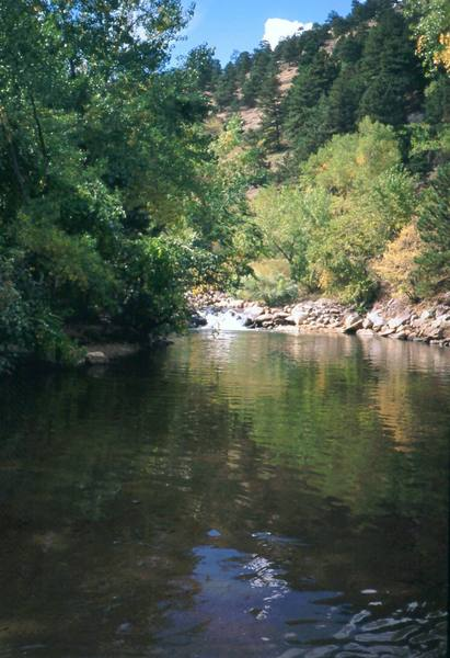 The Boulder Canyon streamside is virtually deserted at mid-weekday but can be a huge social scene on weekends and hot afternoons. This is a good palce to cool your feet after climbing. Photo by Tony Bubb, Y2K.