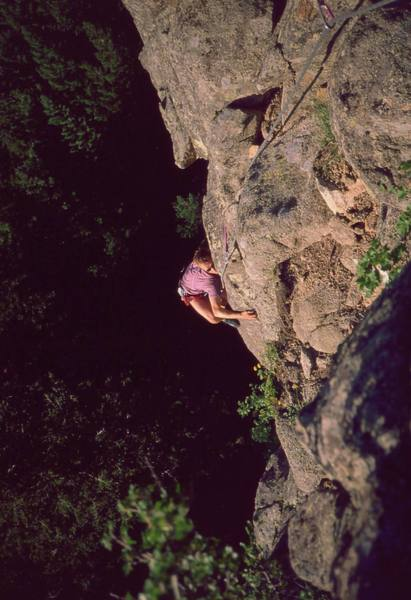 Chris Parks gets some 'Dirty Love' humping the arete at the crux, on Boulder Canyon's Garden Party Wall. Photo by Tony Bubb, 2003.