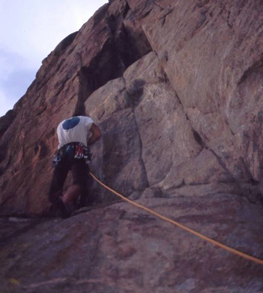 Tony Bubb arrives at the steep section of 'Thumb Tack (5.11+)' at the Bihedral and wiggles in some gear. Don't let the angle of the camera fool you, look at the angle of the rope! Photo by Alan Doak, 2004.