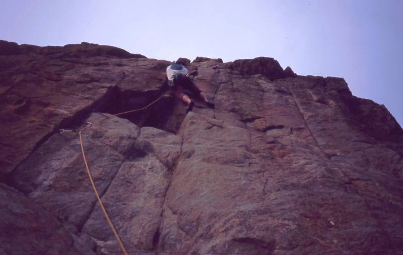 Tony Bubb tries to figure out the crux of 'Thumb Tack (5.11+)' at the Bihedral Rock in Boulder Canyon. The steep crux is protected by a micro-cam or a small nut. Photo by Alan Doak, 2004.