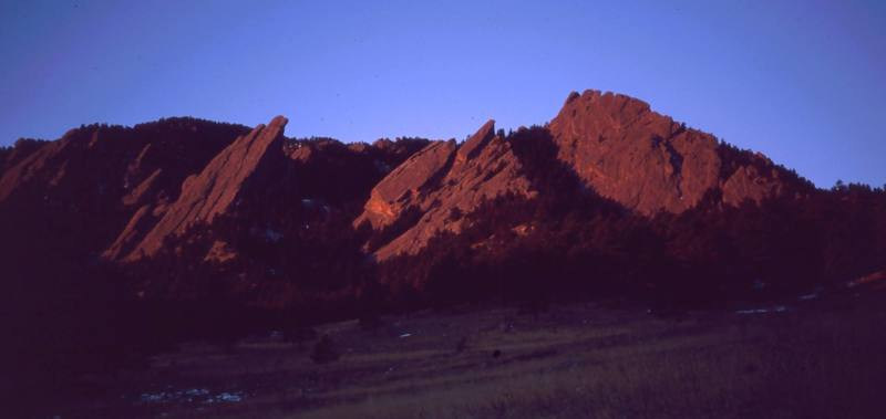 The Flatirons can catch awesome light by morning. Make sure to take at least one sunrise hike there if you visit. Photo by Tony Bubb, 1997.