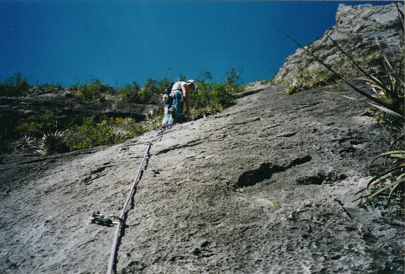 Me belaying my wife up the second pitch. Notice all of the prickly bushes - many a rope had been stuck in these by a careless climber!